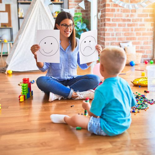 child at play with therapist