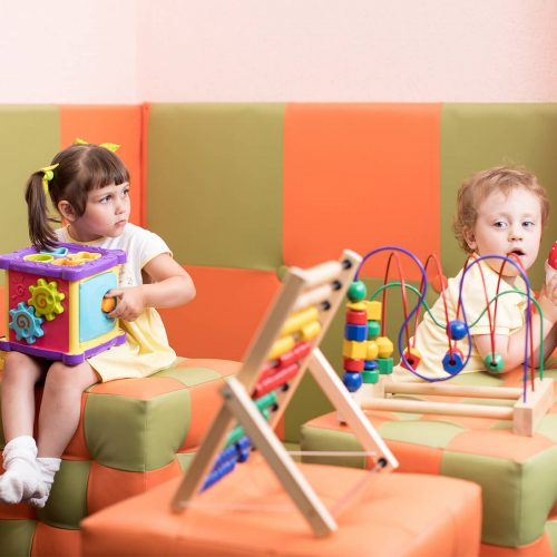 children playing in a waiting area