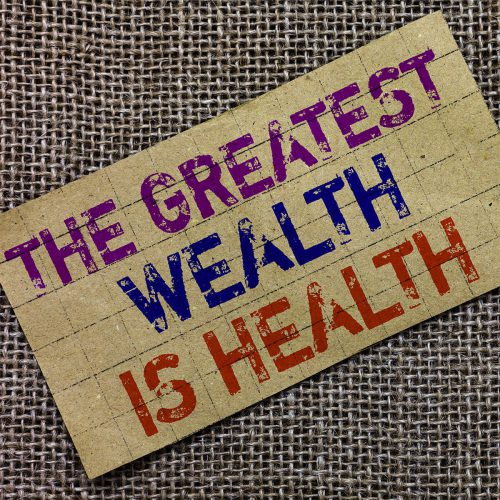 the greatest wealth is health written on a sign