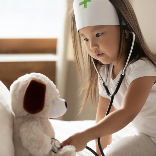 asian girl listening to heartbeat of her teddy bear