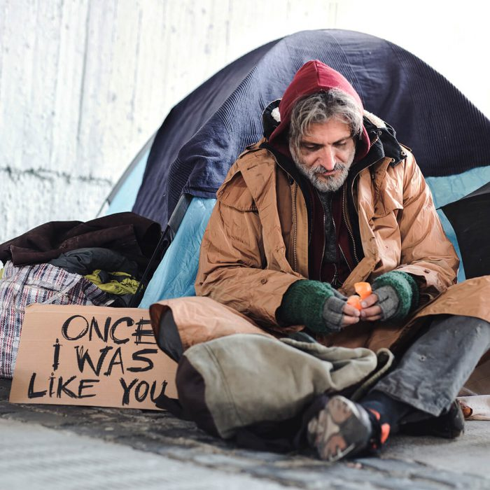 homeless person with sign that reads - once i was like you