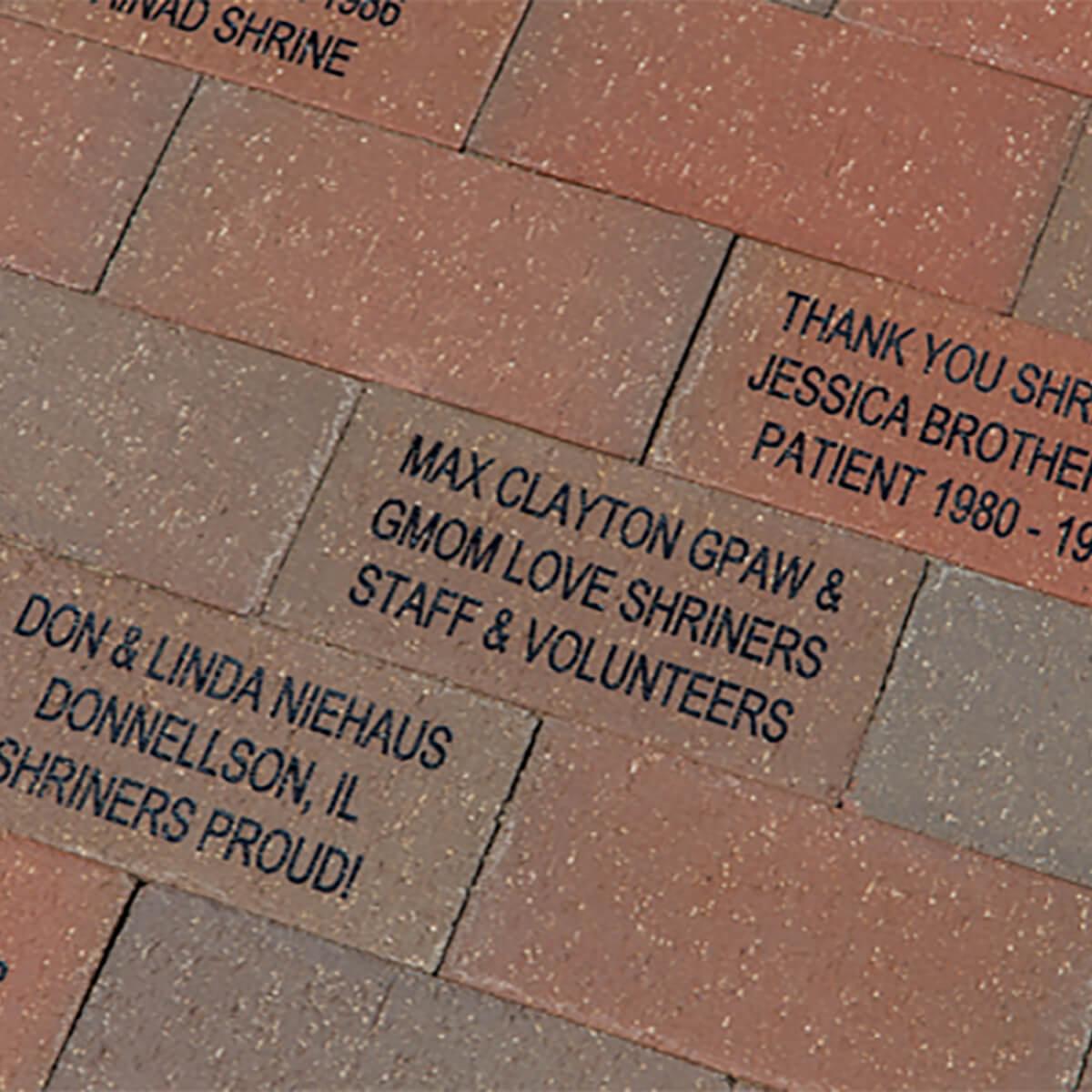 named bricks on entrance