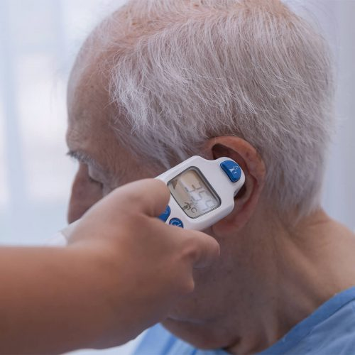 elderly male getting temperature taken