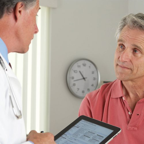 patient receiving checkup and care from physician