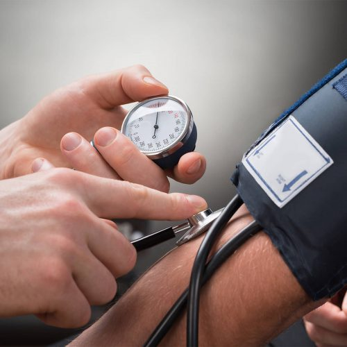 medical professional checking blood pressure of a patient