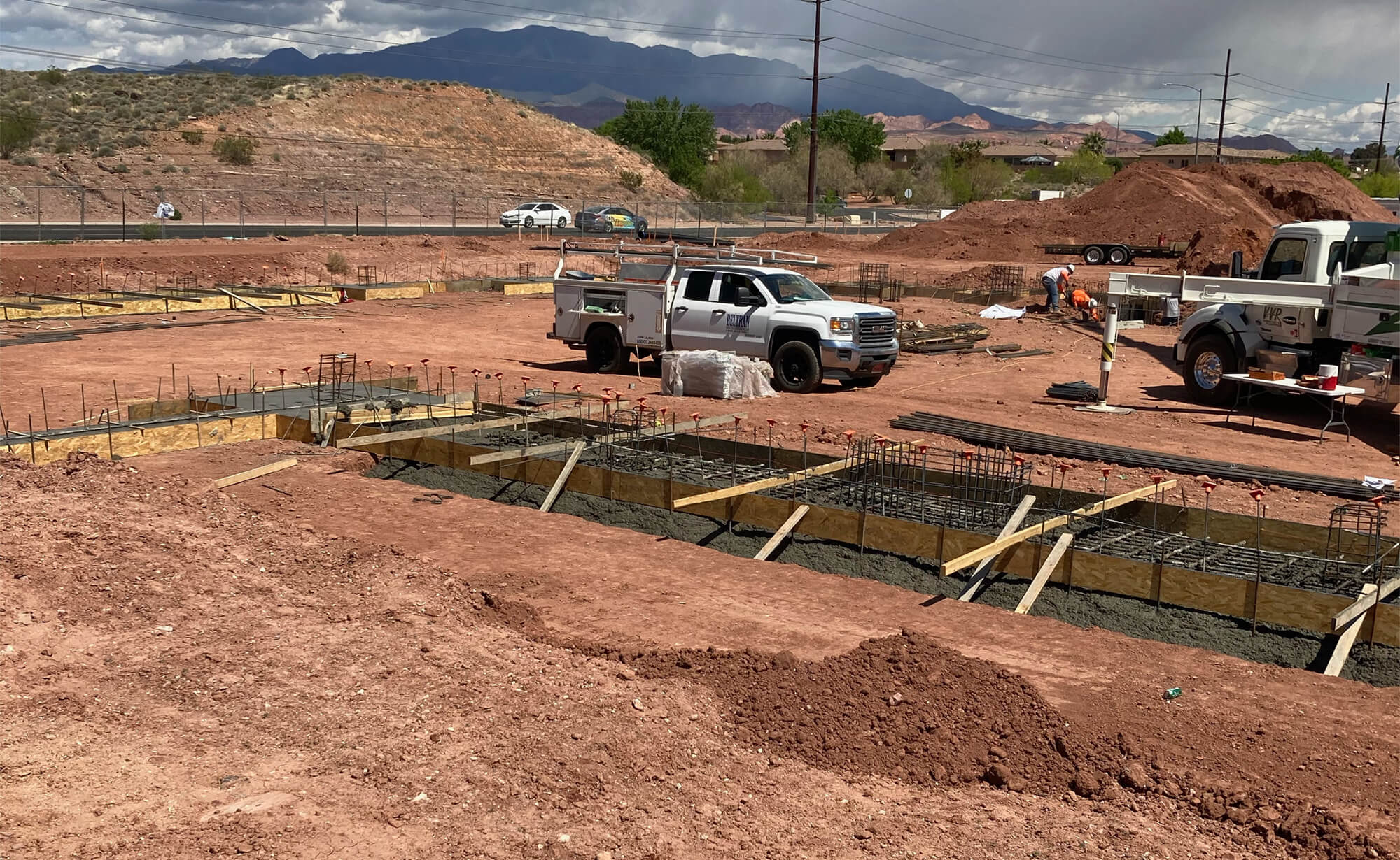 Riverside Clinic building footings in process, partially filled with concrete