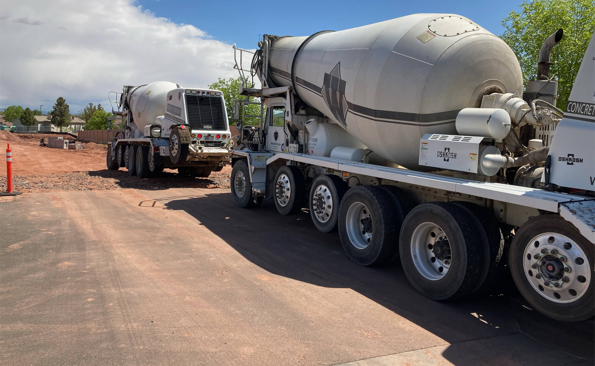two cement trucks waiting their turn at the Riverside Clinic construction site